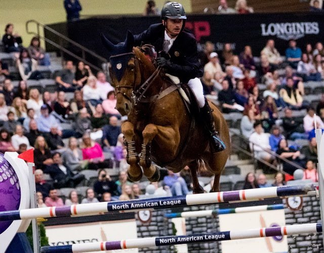 Ireland's Denis Lynch and RMF Echo flying high as they capture a top class win at the Longines FEI World Cup™ Jumping in Lexington (USA) overnight. (FEI/Ashley Neuhof)