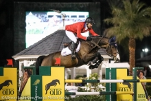 Andy Kocher and Squirt Gun representing the U.S. Show Jumping Team during the 2020 Nations Cup competition.